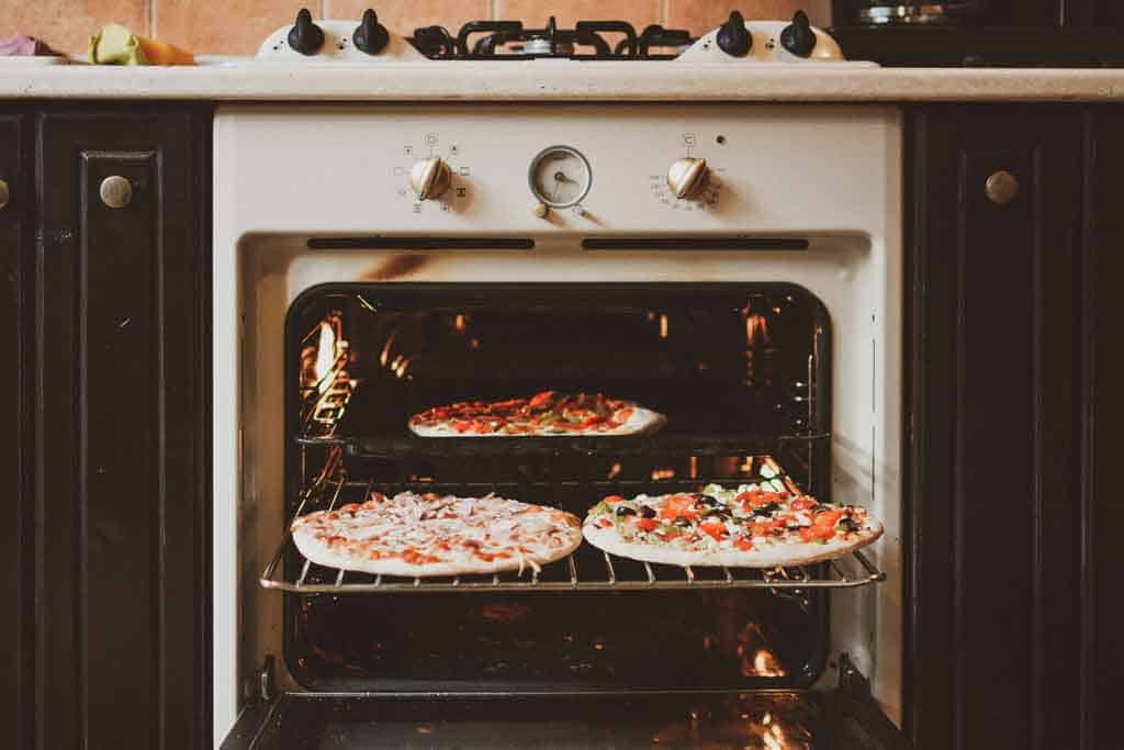 Campervan oven cooking pizza