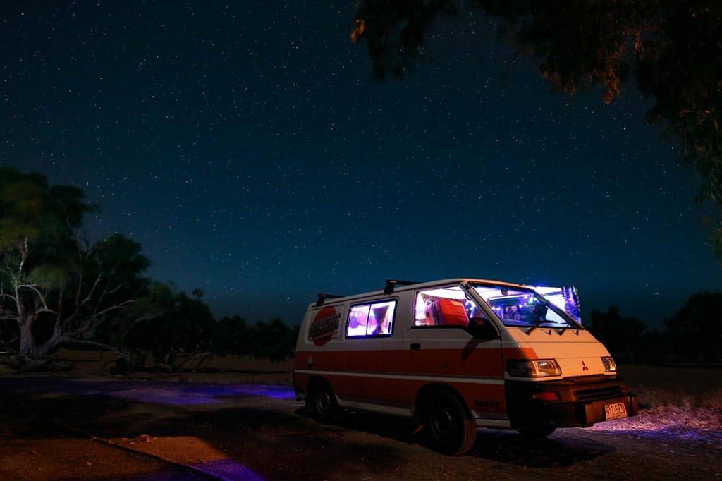 Van in Lights Camping