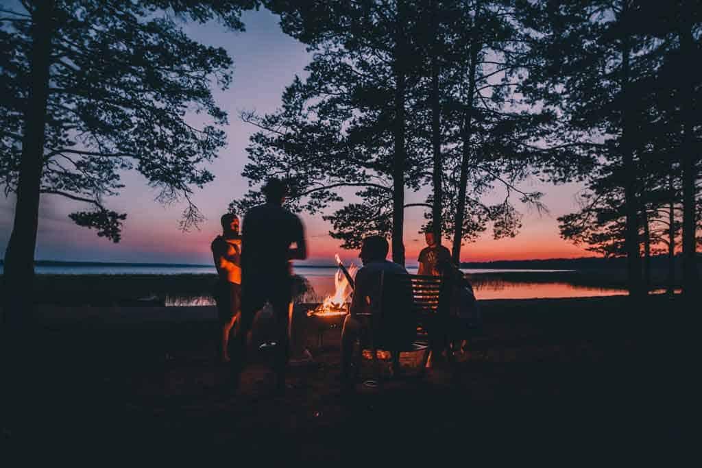 Group Sitting Around Camp Fire